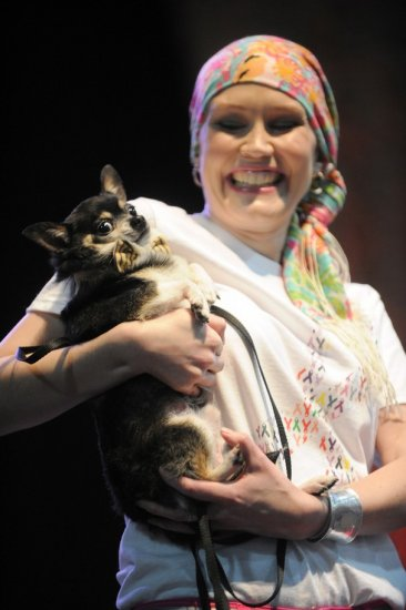 Thompson Cancer Survival Center's Young Survivors' Network member Carson Beaty walks the runway with a chihuahua named Emmett during the News Sentinel Women Today show at the Knoxville Convention Center Saturday, March 17, 2012. Several cancer survivors were featured in the fashion show which included dogs from the Small Breed Animal Rescue of East Tennessee. (Source: Knoxville News Sentinel)
